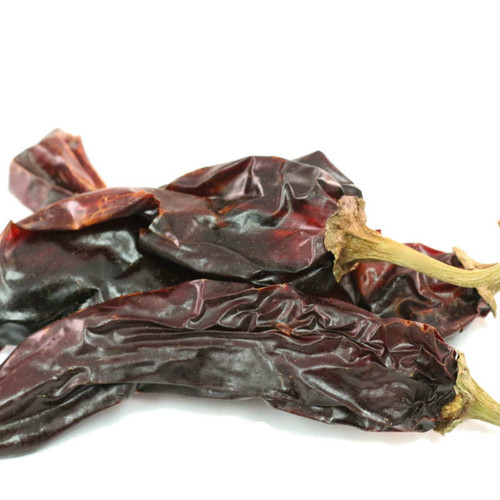 Grown in the famed Hatch Valley of New Mexico, New Mexico Hatch Chiles are celebrated for their unique, complex flavor and mild heat. Their long, thin-fleshed pods have an earthy, slightly smoky flavor with subtle notes of cherry. Incorporate into chili, salsas and sauces. Add bold flavor to soups, stews or rice dishes. Chop and add to marinades for chicken or fish. Mild heat ranging from 700 to 1,250 on Scoville Heat Scale.