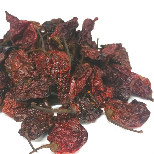 """Ghost Chiles (also called """"Bhut Jolokia"""" in the parts of India where they are cultivated) are among the hottest, most potent chiles on the planet. These dried, whole chiles make storing and using this pungent ingredient effective and economical. Grind and add to seasoning rubs for grilled meats for extreme heatAdd to salsa, beverages or sauces for searingly spicy flavor. Steep in cooking liquid or sauces to extract its exceptional level of heat. Ranges 350,00 to 577,000 on Scoville Heat Scale."""