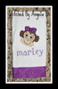 "Stitched example from customer with lowercase letters to spell ""marley"" from our #311 Swirly Dots Font."