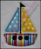 Example of the Diamond Stitch Sailboat with fabric. Madeira Thread Colors Used: #1683 Yellow #1747 Red #1775 Blue #1800 Black