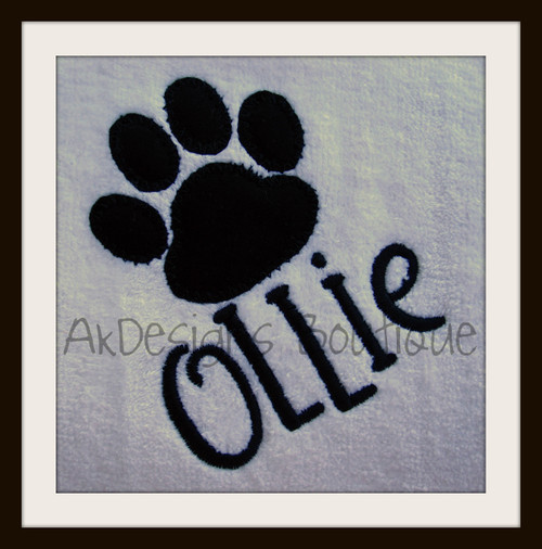 "Stitched on a white towel with our #381 Doodle Font to spell ""Ollie""."