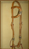 Single Ear Harness Leather Headstall with 8 Plait Natural Rawhide with Black Accent Braided Ear and Cheek Pieces.