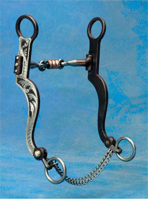 "A well balanced, shanked snaffle bit! 5"", 3 piece snaffle mouth with inlaid copper and dogbone center with copper rollers to keep the mouth moist. 7 1/4"" antique cheeks with hand engraved overlay. The articulated rein rings mean extra sensitivity plus a fine link chain to help keep the bit in place. A good looking bit that will work for just about any horse!"