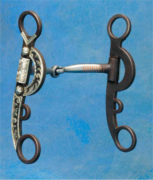 "The Pampas Argentine Snaffle is a flashy update of the traditional Argentine snaffle. 6"" antique brown 4-Rein cheeks with no turn holes for string or rawhide cord. Hand engraved overlay. 5"" copper inlaid snaffle mouth. The mouth has a ""No Pinch"" long barrel where the mouth attaches to cheek. A great transition bit or tune up bit for older horses!"