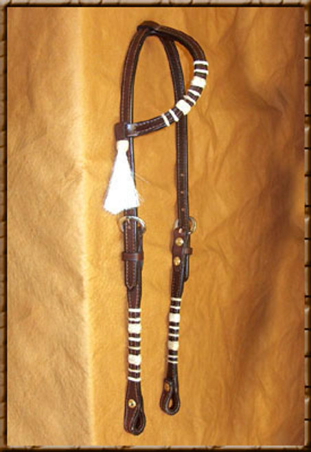 This beautiful headstall (shown in Dark) is great for show or work and at a great price. Made of quality leather with chrome buckles, rawhide accents and horse hair tassel will look stylish on your horse. Come in Light, Dark or Chestnut.
