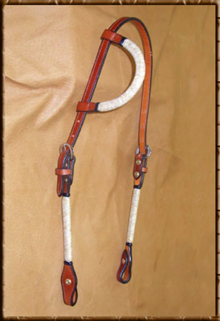 Sliding ear headstall with braided natural rawhide cheeks and ear accents will put a little bling on your horse at a great price. Comes in Light , Dark or Chestnut.