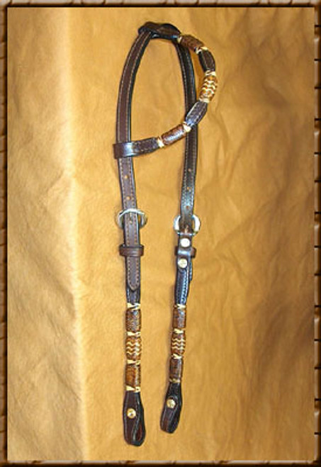 This sliding ear Dyed Rawhide with Light Accents headstall has that classic beauty that will look great on your horse. Come in Light - Dark - Chestnut