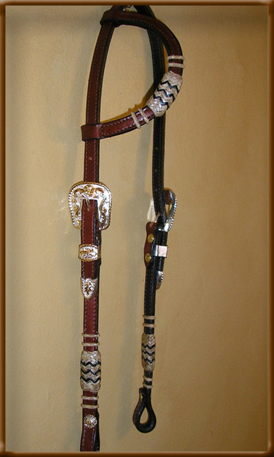 Classic Headstall with Black Accent Braided Cheeks and Ear Piece Highlighted with a Beuatiful Silver/Gold Buckle. Comes in Light Oil - Dark or Chestnut Color.