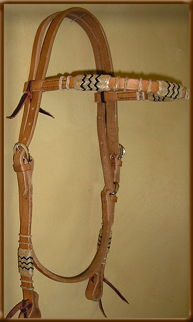 Harness Leather Headstall with Natural Rawhide Braiding and Black Accents on Brow Band and Cheek Pieces.