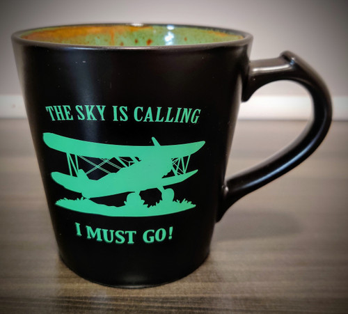 """The Sky is Calling, I Must Go!"" Mug (green)"