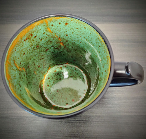Natural variations in the glaze on the inside of the mug.