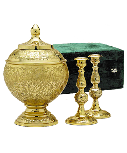 Brass memorial cremation urn for ashes with candlesticks.