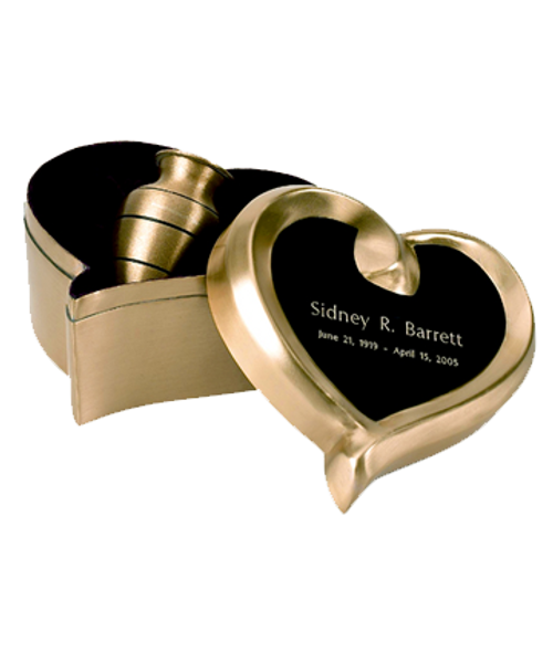 Brushed brass ultra keepsake token cremation urn for ashes in a heart shaped case.