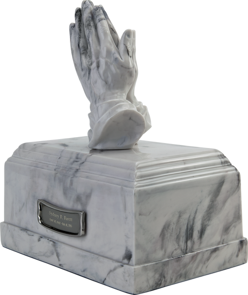 Praying hands sculpture religious cremation urn for ashes.