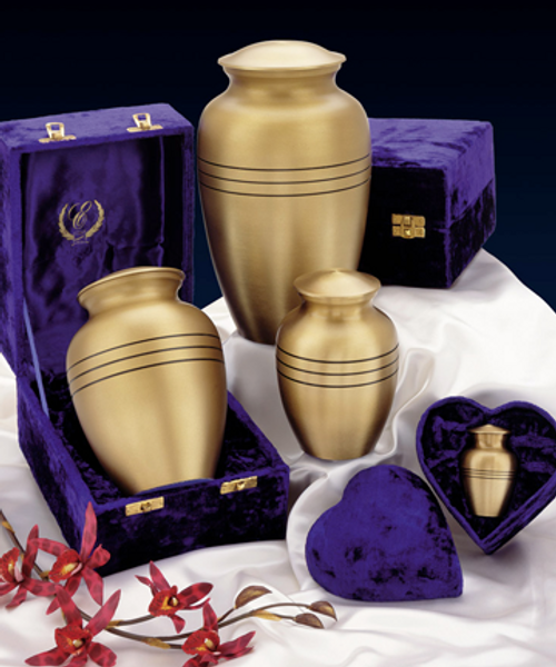 Classic brass memorial cremation pet urn for ashes group shot.