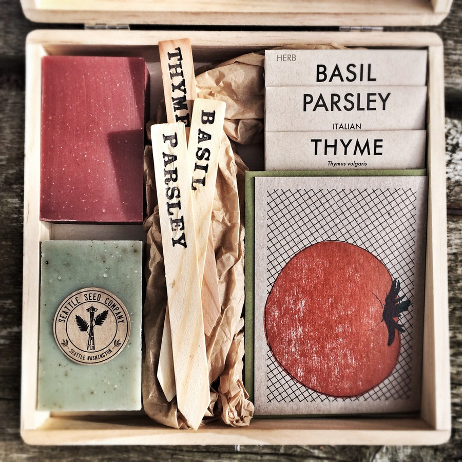 2 soaps, 4 packets of seeds, a card and 3 garden markers in a solid wood gift box.