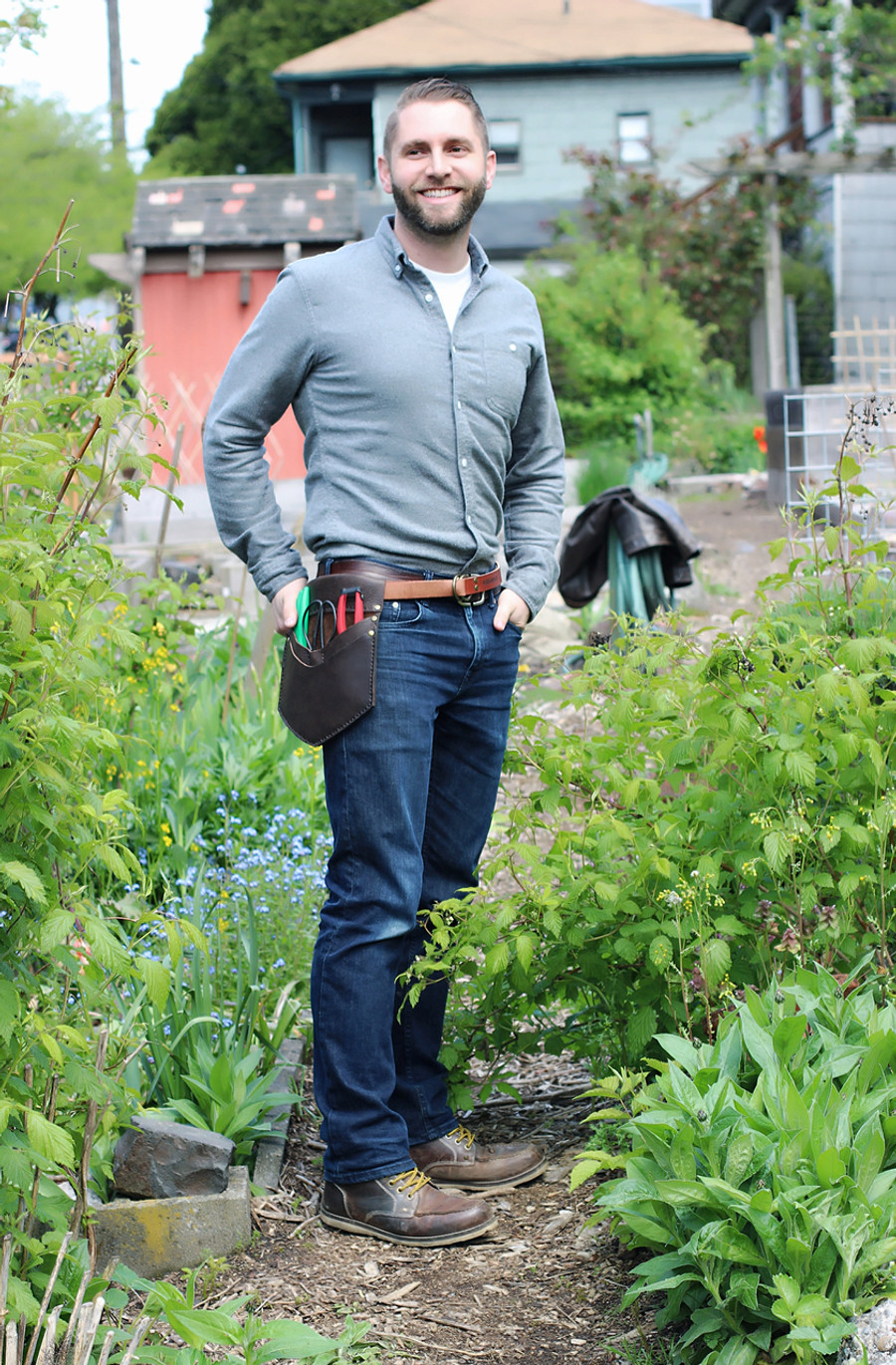 Seattle Seed Co. founder Sander wearing his Harvest Essentials belt.