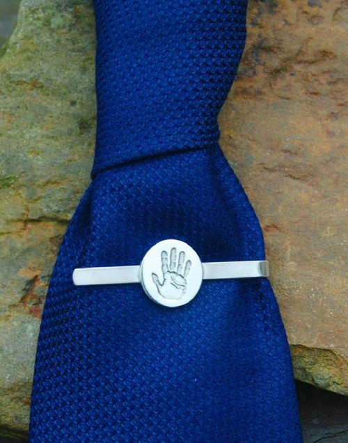 Sterling silver tie slide and a fine silver handprint charm