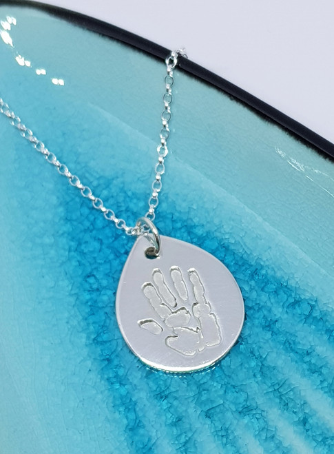 Our large sterling silver teardrop necklace is the perfect way to capture the moment