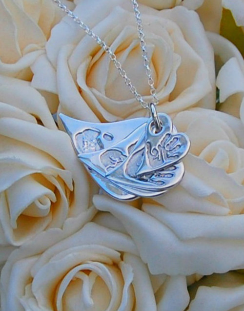 Fine silver four stacked wavy heart pendants and sterling silver chain