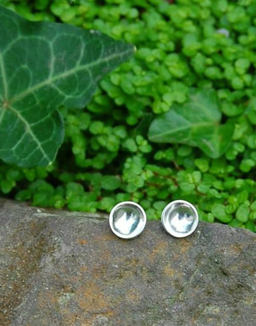 Elegant concave silver stud earrings