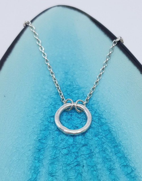 Delicate silver circle halo necklace