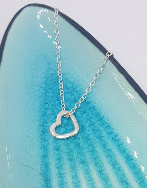 Delicate sterling silver open heart on sterling silver chain