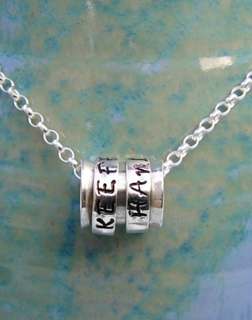 Sterling silver spinner pendant with two rings on Belcher chain