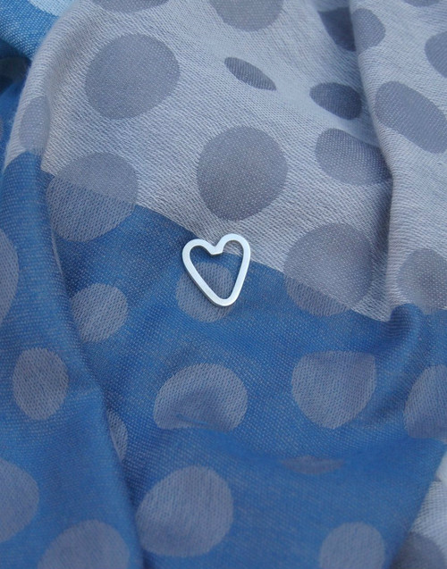 Elegant heart pin on scarf