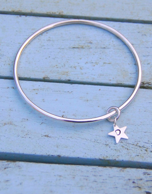 Silver initial star with loved one's initial