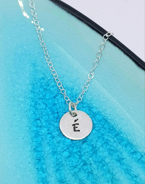 Our sterling silver initial circle charm and chain is the perfect way to keep your loved one close