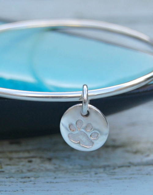 Elegant sterling silver bangle with paw print circle charm