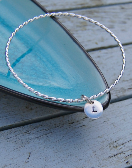 Chic twist sterling silver bangle with initial silver charm