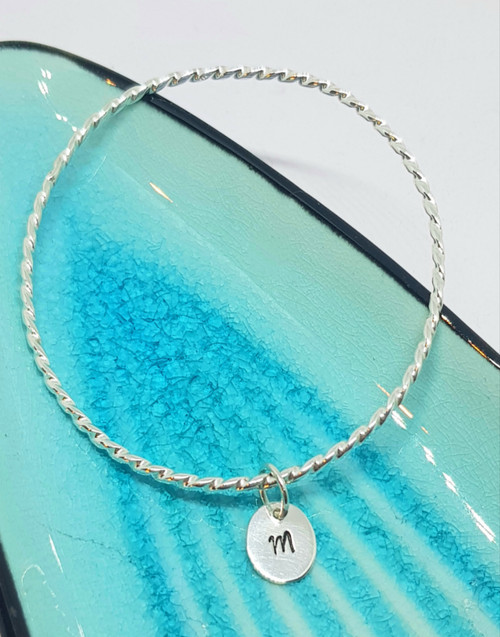 Elegant twist with our initial charm - personalised for you