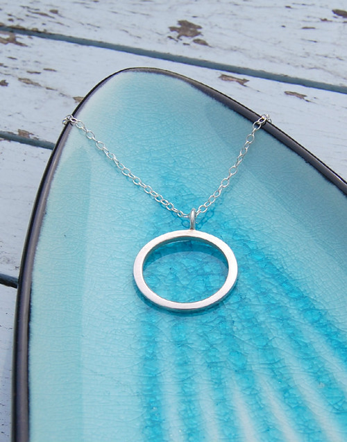 Classic yet contemporary silver circle drop necklace