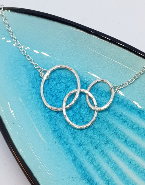 Our sterling silver Generations necklace that represents the love that links us all