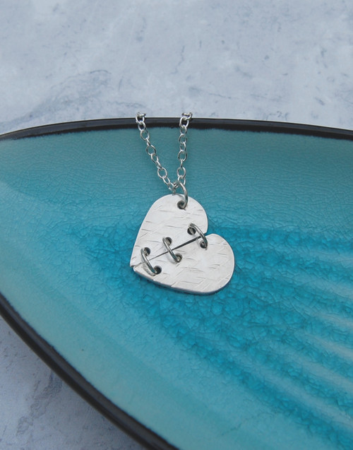 Elegant textured mended silver heart necklace