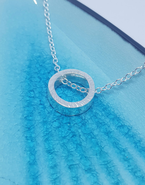 Silver circle textured slider necklace