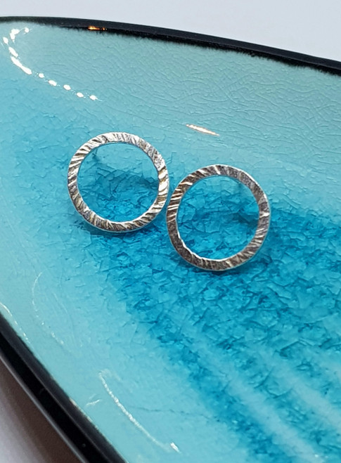 Sterling silver circle textured stud earrings