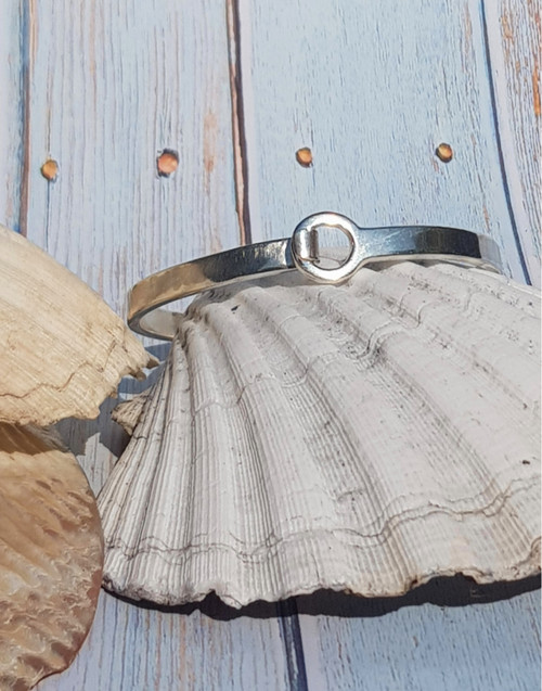 Sterling silver hook & eye bangle bracelet has an eye-catching clasp feature