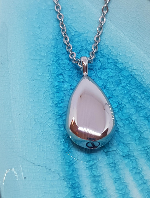 Sleek dewdrop urn pendant and chain to hold a treasured memory