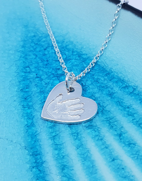 Sterling silver small heart charm necklace