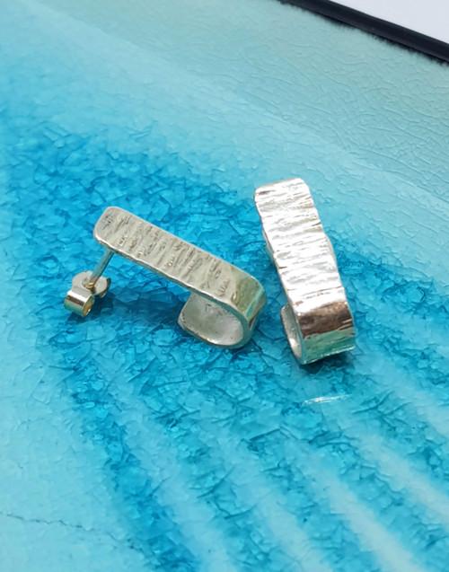 Chic sterling silver hook textured stud earrings