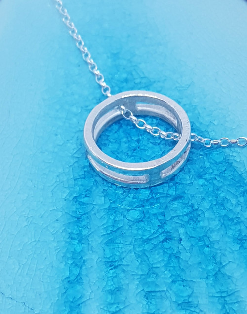 Sterling silver cage slider necklace, with its petite frame for those who seek something.