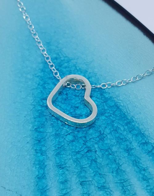 Elegant sterling silver heart slider necklace
