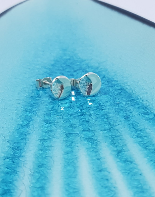 Our silver Moon and Back stud earrings are gently textured which represents the world and the high shine crescent is soldered directly to the world mirroring the bond of connection showing the love