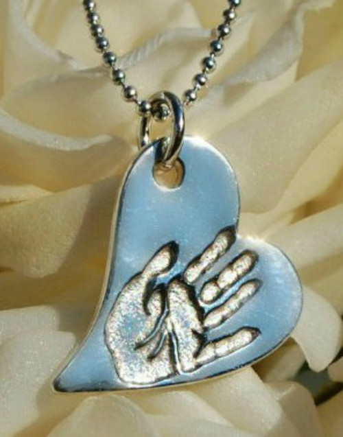 Sterling silver chain and fine silver wavy heart pendant