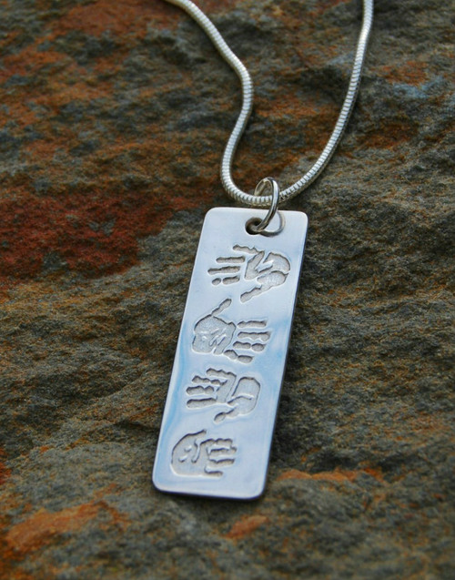 Sterling silver print dogtag pendant and sterling silver necklace chain. Four prints dogtag pendant
