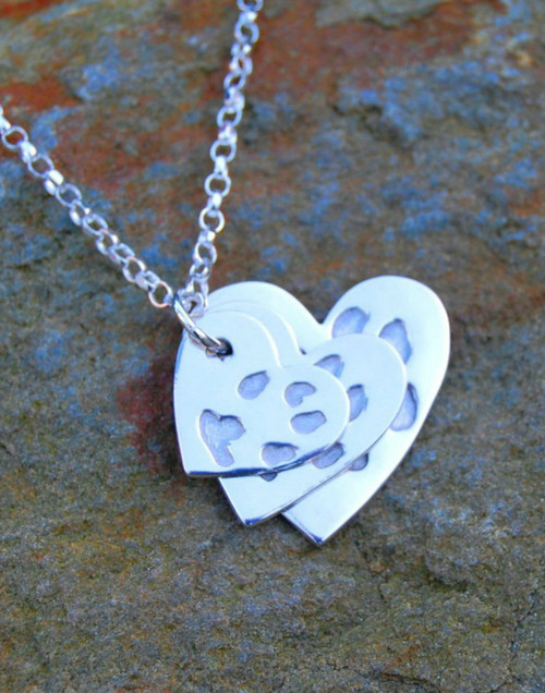 Fine silver traditional heart paw print pendants and sterling silver jumpring and chain. We love our pets so its nice to keep them close