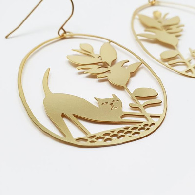 Pickles the Cat Dangles in Gold
